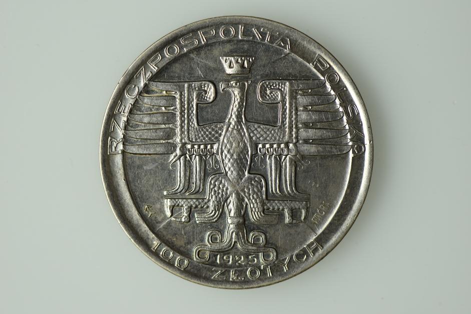 Moneta próbna 100 złotych, 1925 r., projekt Stanisław Szukalski. Zbiory NBP.